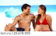 Купить «Smiling couple discussing», видеоролик № 29678959, снято 15 ноября 2011 г. (c) Wavebreak Media / Фотобанк Лори