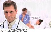 Купить «Surgeon sitting in front of his patient», видеоролик № 29679727, снято 4 ноября 2011 г. (c) Wavebreak Media / Фотобанк Лори
