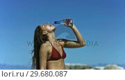 Купить «Brunette drinking water in slow motion», видеоролик № 29680087, снято 15 ноября 2011 г. (c) Wavebreak Media / Фотобанк Лори