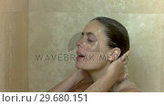 Купить «Brunette taking a shower in slow motion», видеоролик № 29680151, снято 7 ноября 2011 г. (c) Wavebreak Media / Фотобанк Лори