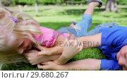 Купить «Boy and a girl tickling each other on the grass», видеоролик № 29680267, снято 17 ноября 2011 г. (c) Wavebreak Media / Фотобанк Лори