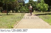 Купить «A woman jogs past the camera and down a footpath», видеоролик № 29680387, снято 17 ноября 2011 г. (c) Wavebreak Media / Фотобанк Лори
