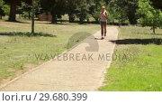 Купить «A woman jogs up a footpath past the camera», видеоролик № 29680399, снято 17 ноября 2011 г. (c) Wavebreak Media / Фотобанк Лори