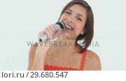 Купить «The Karaoke Girl», видеоролик № 29680547, снято 11 ноября 2011 г. (c) Wavebreak Media / Фотобанк Лори