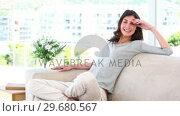 Купить «Woman relaxing on couch», видеоролик № 29680567, снято 11 ноября 2011 г. (c) Wavebreak Media / Фотобанк Лори