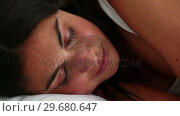 Купить «Brunette haired woman sleeping», видеоролик № 29680647, снято 11 ноября 2011 г. (c) Wavebreak Media / Фотобанк Лори