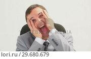 Купить «Businessman shouting while sitting on a swivel chair», видеоролик № 29680679, снято 22 ноября 2011 г. (c) Wavebreak Media / Фотобанк Лори