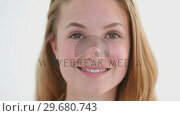 Купить «Attractive blonde woman looking at the camera», видеоролик № 29680743, снято 22 ноября 2011 г. (c) Wavebreak Media / Фотобанк Лори