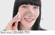 Купить «Smiling brunette using a cotton pad», видеоролик № 29680751, снято 22 ноября 2011 г. (c) Wavebreak Media / Фотобанк Лори