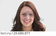 Купить «Brunette showing a beaming smile», видеоролик № 29680871, снято 22 ноября 2011 г. (c) Wavebreak Media / Фотобанк Лори