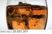Купить «Liquid in super slow motion being poured in a glass», видеоролик № 29681391, снято 1 марта 2012 г. (c) Wavebreak Media / Фотобанк Лори