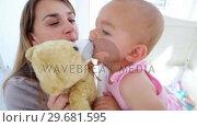 Купить «Baby girl kissing her teddy bear», видеоролик № 29681595, снято 25 ноября 2011 г. (c) Wavebreak Media / Фотобанк Лори