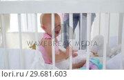 Купить «Woman giving a doll to a baby», видеоролик № 29681603, снято 25 ноября 2011 г. (c) Wavebreak Media / Фотобанк Лори
