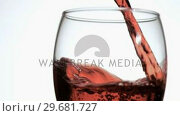 Купить «Red wine in super slow motion falling in a glass», видеоролик № 29681727, снято 23 мая 2019 г. (c) Wavebreak Media / Фотобанк Лори