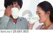 Купить «Man and a woman having a discussion while drinking a cup of coffee», видеоролик № 29681803, снято 25 ноября 2011 г. (c) Wavebreak Media / Фотобанк Лори