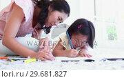Купить «Mother looking at her daughter as she colours», видеоролик № 29681827, снято 25 ноября 2011 г. (c) Wavebreak Media / Фотобанк Лори
