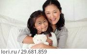 Купить «Mother hugging her daughter», видеоролик № 29681859, снято 25 ноября 2011 г. (c) Wavebreak Media / Фотобанк Лори