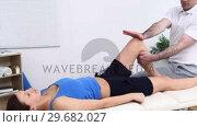 Купить «Woman being massaged by a physiotherapist», видеоролик № 29682027, снято 21 марта 2012 г. (c) Wavebreak Media / Фотобанк Лори
