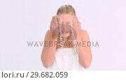 Купить «Woman cleaning in super slow motion her face», видеоролик № 29682059, снято 12 апреля 2012 г. (c) Wavebreak Media / Фотобанк Лори