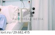 Купить «Sleeping pregnant woman lying on a bed while holding her belly», видеоролик № 29682415, снято 24 апреля 2012 г. (c) Wavebreak Media / Фотобанк Лори
