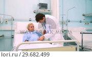 Купить «Doctor using a stethoscope on a pregnant woman», видеоролик № 29682499, снято 24 апреля 2012 г. (c) Wavebreak Media / Фотобанк Лори