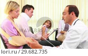 Купить «Injured woman talking to a doctor in the waiting room», видеоролик № 29682735, снято 27 апреля 2012 г. (c) Wavebreak Media / Фотобанк Лори