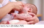 Mother breastfeeding a new born baby boy. Стоковое видео, агентство Wavebreak Media / Фотобанк Лори
