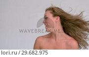 Купить «Attractive woman shaking her hair», видеоролик № 29682975, снято 22 августа 2012 г. (c) Wavebreak Media / Фотобанк Лори