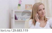 Купить «Blonde woman calling her friend », видеоролик № 29683119, снято 28 сентября 2012 г. (c) Wavebreak Media / Фотобанк Лори