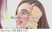 Купить «Woman getting eye shadow applied», видеоролик № 29683131, снято 27 августа 2012 г. (c) Wavebreak Media / Фотобанк Лори