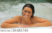 Купить «Laughing woman in a jacuzzi», видеоролик № 29683143, снято 2 октября 2012 г. (c) Wavebreak Media / Фотобанк Лори