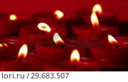 Red candles flickering in the breeze. Стоковое видео, агентство Wavebreak Media / Фотобанк Лори