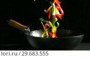 Купить «Mixed sliced peppers falling into wok», видеоролик № 29683555, снято 2 марта 2012 г. (c) Wavebreak Media / Фотобанк Лори