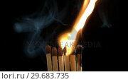 Купить «Burning matches», видеоролик № 29683735, снято 22 ноября 2012 г. (c) Wavebreak Media / Фотобанк Лори