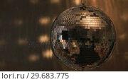 Купить «Shiny disco ball spinning around», видеоролик № 29683775, снято 18 января 2013 г. (c) Wavebreak Media / Фотобанк Лори