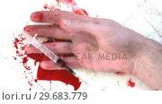 Купить «Hand holding syringe falling dead», видеоролик № 29683779, снято 18 января 2013 г. (c) Wavebreak Media / Фотобанк Лори
