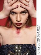 Купить «Portrait of a serious woman with makeup posing.», фото № 29684027, снято 19 марта 2016 г. (c) Сергей Сухоруков / Фотобанк Лори
