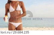 Купить «Woman with a drawing of sun made with cream on her body», видеоролик № 29684235, снято 26 марта 2013 г. (c) Wavebreak Media / Фотобанк Лори