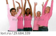 Group of cheerful women raising arms for breast cancer awareness. Стоковое видео, агентство Wavebreak Media / Фотобанк Лори