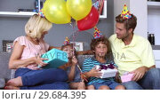 Купить «Family celebrating a birthday together», видеоролик № 29684395, снято 22 марта 2013 г. (c) Wavebreak Media / Фотобанк Лори