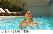 Купить «Woman emerging from swimming pool», видеоролик № 29684439, снято 25 марта 2013 г. (c) Wavebreak Media / Фотобанк Лори