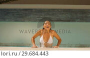 Купить «Woman getting out of swimming pool», видеоролик № 29684443, снято 25 марта 2013 г. (c) Wavebreak Media / Фотобанк Лори