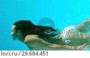 Купить «Woman swimming underwater», видеоролик № 29684451, снято 25 марта 2013 г. (c) Wavebreak Media / Фотобанк Лори