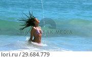 Купить «Woman tossing her hair with sensuality», видеоролик № 29684779, снято 4 апреля 2013 г. (c) Wavebreak Media / Фотобанк Лори