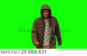 Купить «Man with a coat walking toward camera on green screen», видеоролик № 29684831, снято 7 апреля 2013 г. (c) Wavebreak Media / Фотобанк Лори