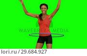 Купить «Woman playing with a hula hoop on green screen», видеоролик № 29684927, снято 7 апреля 2013 г. (c) Wavebreak Media / Фотобанк Лори