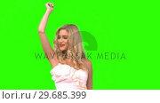 Attractive woman dancing in wedding gown on green screen. Стоковое видео, агентство Wavebreak Media / Фотобанк Лори