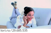 Купить «Attractive businesswoman lying on couch and speaking on the phone», видеоролик № 29685535, снято 10 июля 2013 г. (c) Wavebreak Media / Фотобанк Лори