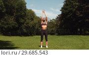 Купить «Sporty woman doing breathing exercise», видеоролик № 29685543, снято 5 июля 2013 г. (c) Wavebreak Media / Фотобанк Лори