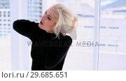 Купить «Cute woman suffering from neck pain», видеоролик № 29685651, снято 6 августа 2013 г. (c) Wavebreak Media / Фотобанк Лори